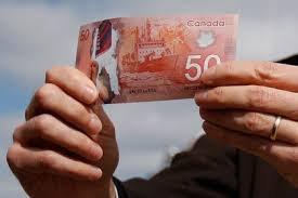 Канадский доллар резко подешевел против американской валюты