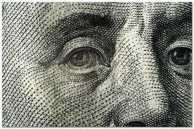 Доллар растет, а инвесторы ожидают заседания ФРС