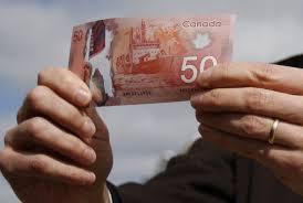 Канадский доллар ослабился, так как США планируют ввести тариф на древесину