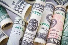 Трейдеры ожидают, что доллар продолжит страдать в 2018-м